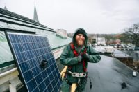 Guy by solar panel