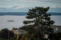 A ferry crosses the Puget Sound as seen from West Seattle