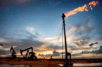 Metahane gas is burned off near an oil drilling site close to Carlsbad