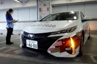 A Toyota Prius Prime outfitted for the use at Tokyo Olympics