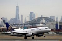 A United Airlines taking off with New York City as a backdrop