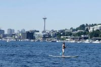 A person riding on a paddle board on Lake Union in Seattle