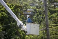A worker fixing power lines