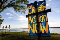 Calls for climate action and line 3 pipeline protest signs are seen during a faith gathering and prayer circle in Minnesota