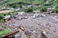 Rescue workers searching for survivors in Himachal Pradesh State after rain induced landslides