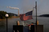 US flag flying on a towboat