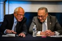 Chuck Schumer and Bernie Sanders smiling