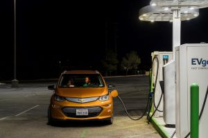 A Chevrolet Bolt at a charging station in Victorville, Calif. By setting a clear target for electric vehicle sales, President Biden is adding momentum to the shift to clean transportation.