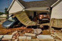 A home in Waverly, Tenn., on Tuesday. At least 20 people were killed in floods that hit the state over the weekend.