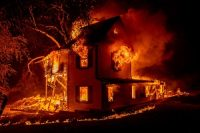 A home on Jeters Road burns from the Dixie Fire south of Janesville, Calif., on Aug. 16