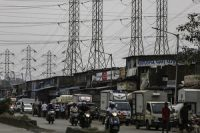 Electrical power lines above a road in Mumbai.