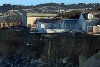 Homes dangle on the edge of seaside cliff in Pacifica.
