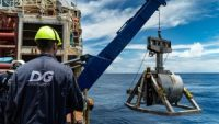 Researchers with Deepgreen Metals deploy a box core tool to capture a sample of the sea floor