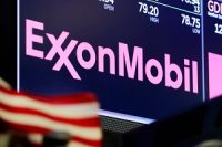 The logo for ExxonMobil appears above a trading post on the floor of the New York Stock Exchange in 2018.