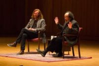 Tom Toles (left) speaks with his friend and SUNY Buffalo Arts initiative co-director Bruce Jackson (right) at Slee Hall on April 14, 2016
