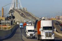 Trucks move across Terminal Island, which is shared by the ports of Los Angeles and Long Beach