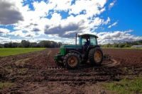 A tractor tills the soil at Brookford Farm in Canterbury adding lime and natural cow manure to enrich the soil on Friday, September 3, 2021
