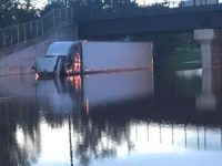A tractor-trailer is submerged on Route 206 in Raritan on Thursday morning from massive flooding