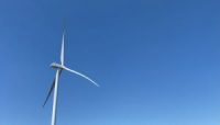 A wind turbine towers above Queen City, Missouri. Ameren, the electrical provider for much of eastern Missouri, acquired the High Prairie Renewable Energy Center in late 2020.