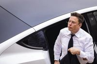 Elon Musk arrives at court during a trial over energy subsidiary SolarCity in Wilmington, Del., on July 13.