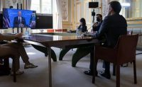French President Emmanuel Macron listens to President Biden from Paris during the virtual climate summit on Thursday