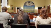 Lyle Jack and other OSPA officials testify before a Congressional committee.