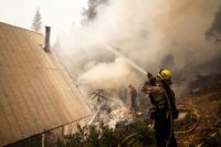 San Marcos firefighters worked to save a burning cabin from the Caldor Fire in South Lake Tahoe earlier this week.