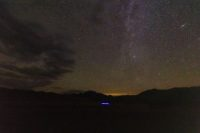 Smoke from wildfires in the West stained the normally crystalline night sky at Great Sand Dunes National Park in Colorado on Thursday,
