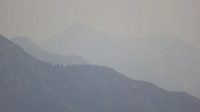 Smoky air hangs over the Wasatch Mountains on Tuesday, Aug. 10, 2021.