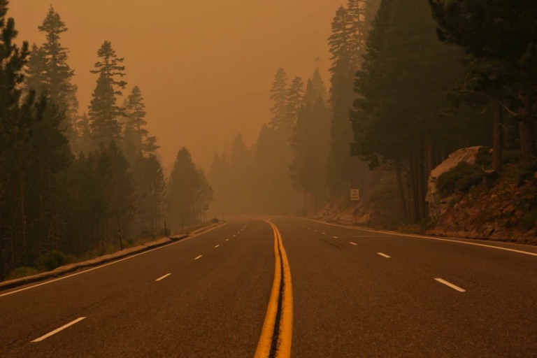 Heavy smoke from the Caldor fire hangs over Highway 50 near South Lake Tahoe