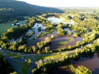 A drone photo taken late Thursday shows the Route 185 and E. Weatogue intersection in Simsbury. In the distance, water is across Nod Road.