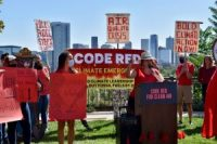 Activist Lucy Molina speaks at a rally calling on Colorado policymakers to act more aggressively on climate change on Sept. 16, 2021.